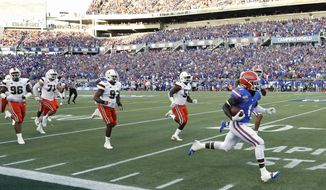Florida wide receiver Kadarius Toney, right, runs past the Miami defense on a 66-yard touchdown reception during the first half of an NCAA college football game Saturday, Aug. 24, 2019, in Orlando, Fla. (AP Photo/John Raoux)
