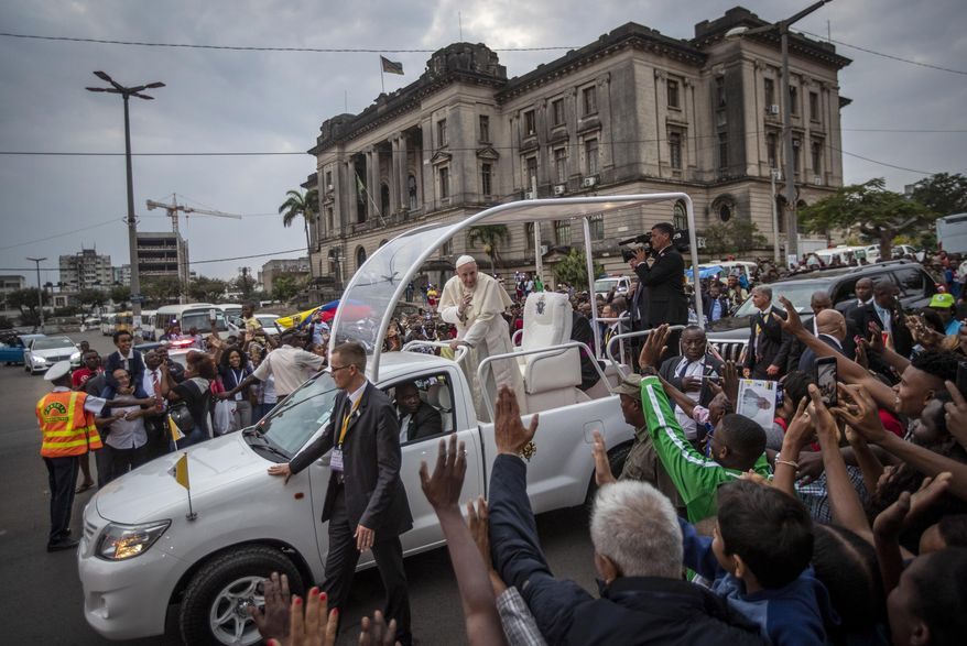 Pope Francis waves to wellwishers as he leaves after a meeting at the Cathedral of the Immaculate Conception in the capital Maputo, Mozambique Thursday, Sept. 5, 2019. Pope Francis is opening a three-nation pilgrimage to southern Africa with a strategic visit to Mozambique, just weeks after the country's ruling party and armed opposition signed a new peace deal and weeks before national elections. (AP Photo/Ben Curtis)