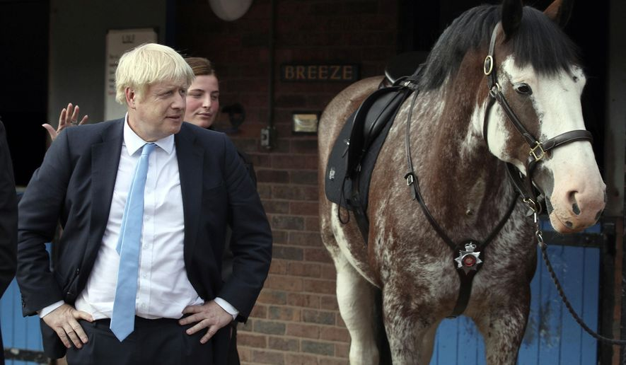 Britain's Prime Minister Boris Johnson looks on during a visit to West Yorkshire in England, Thursday, Sept. 5, 2019. Prime Minister Boris Johnson kept up his push Thursday for an early general election as a way to break Britain's Brexit impasse, as lawmakers moved to stop the U.K. leaving the European Union next month without a divorce deal. (Danny Lawson/PA via AP)