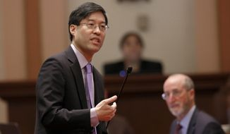 In this Wednesday, Sept. 4, 2019 photo, state Sen. Richard Pan, D-Sacramento, urges lawmakers to approve his measure, SB276, to tighten the rules on giving exemptions for vaccinations, in Sacramento, Calif. Pan announced, Friday, Sept. 6, 2019, that he is accepting additional changes to the bill requested by Gov. Gavin Newsom. (AP Photo/Rich Pedroncelli)