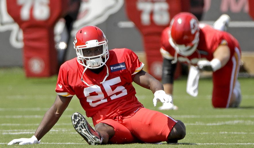 Kansas City Chiefs running back LeSean McCoy (25) warms up with teammates during NFL football practice at the team's training facility Wednesday, Sept. 4, 2019, in Kansas City, Mo. (AP Photo/Charlie Riedel)