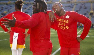 Kansas City Chiefs' Tyreek Hill and Mecole Hardman have some fun before a preseason NFL football game Thursday, Aug. 29, 2019, in Green Bay, Wis. (AP Photo/Matt Ludtke)