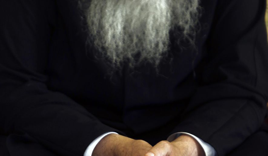 A priest sits at the Archbishopric in Nicosia, Cyprus on Friday, Sept. 6, 2019. Chrysostomos says he will ask the Russian Orthodox Patriarch to act so that a Russian priest stops conducting liturgical services at a pair of churches in the breakaway, Turkish Cypriot north of the ethnically divided island nation. (AP Photo/Petros Karadjias)
