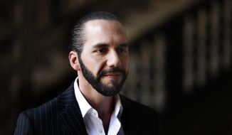 FILE - In this March 12, 2019 file photo, El Salvador's President-elect Nayib Bukele speaks to the press at Mexico's National Palace after meeting with the President Andres Manuel Lopez Obrador in Mexico City. Bukele has inaugurated on Friday, Sept. 6, an anti-corruption commission with support from the Organization of American States. The move comes just after a similar U.N.-backed commission was shut down in Guatemala. (AP Photo/Marco Ugarte, File)