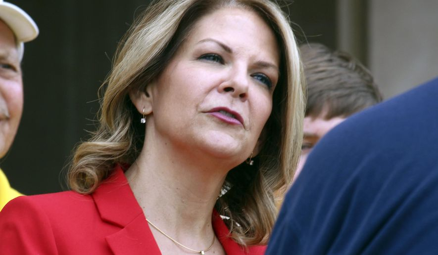 "FILE - In this May 2, 2018 file photo, Arizona Republican U.S. Senate candidate Kelli Ward speaks to the media at the state Capitol in Phoenix. Now the head of the head of the Arizona Republican Party, Ward said in a fundraising email that Democratic Senate candidate Mark Kelly will be stopped ""dead in his tracks."" The comment by Ward sparked an outcry from Democrats Friday, Sept. 6, 2019. Kelly became a prominent gun-control advocate after his wife, Gabrielle Giffords, was critically injured in a mass shooting while she was a member of Congress. (AP Photo/Bob Christie, File)"