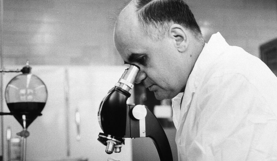 File - In this March 7, 1963, file photo, Dr. Maurice Hilleman, Director of virus and cell biology research, Merck Institute of Therapeutic research at West Point, checks the growth of a virus in roller tube tissue culture in Pennsylvania. Montana State University is celebrating what would have been the 100th birthday of the scientist credited with saving millions of lives through the development of vaccines against measles, mumps and other diseases. Maurice Hilleman was born in Miles City in 1919, graduated from MSU in 1941 and died in 2005. The first Hilleman scholars are set to graduate from MSU this year. (AP Photo/file)