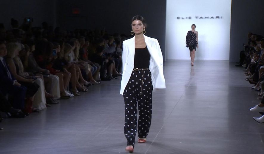 This Thursday, Sept. 5, 2019 image taken from video shows a model wearing fashion from the Elie Tahari Spring/Summer 2020 collection during Fashion Week in New York. (AP Photo/Mark Cohen)