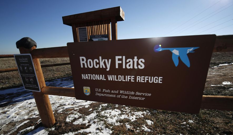 FILE - In this Nov. 18, 2018, file photo, a sign marks a trailhead at the Rocky Flats National Wildlife Refuge in Broomfield, Colo., outside Denver. On Friday, Sept. 6, 2019, the U.S. Fish and Wildlife Service released the results of 48 soil samples on the refuge that found no radioactivity above the cleanup standard. The refuge is on the buffer zone around the former Rocky Flats nuclear weapons plant, which made plutonium triggers for warheads. Earlier tests from a different part of the buffer zone found elevated levels of plutonium, while a second test from the same area showed lower levels. (AP Photo/David Zalubowski, File)