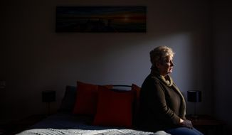 Deb Ware sits for a photo in the room of her home where her son Sam had been staying periodically for the past three years while battling an opioid addiction, in Fountaindale, Central Coast, Australia, Thursday, July 18, 2019. For three years, Deb has battled to save Sam's life, a lonely war against a system that made pharmaceutical opioids cheap and easy to get, in a country that has quietly endured what was once thought to be a uniquely American crisis of skyrocketing opioid addiction and deaths. (AP Photo/David Goldman)