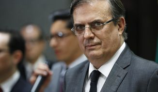 In this Aug. 5, 2019 file photo, Mexican Foreign Minister Marcelo Ebrard gives a news conference, on the mass shooting at a shopping complex in El Paso, Texas. Ebrard is to give a final report on Mexican government efforts Friday, Sept. 5, three months after threats by U.S. President Donald Trump to impose tariffs on Mexico unless it cracked down on hundreds of thousands of mainly Central American migrants arriving at the U.S. border. (AP Photo/John Locher, File)