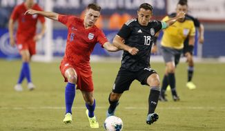 Mexico midfielder Andres Guardado (18) defends against U.S. midfielder Wil Trapp (6) during the first half of an international friendly soccer match Friday, Sept. 6, 2019, in East Rutherford, N.J. (AP Photo/Kathy Willens)