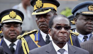 FILE - In this Saturday, Oct. 31, 2009, file photo Zimbabwe President Robert Mugabe arrives for the burial of a prominent member of his party, Misheck Chando, in Harare. On Friday, Sept. 6, 2019, Zimbabwe President Emmerson Mnangagwa said his predecessor Robert Mugabe, age 95, has died. (AP Photo/Tsvangirayi Mukwazhi, File)