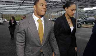 FILE - In this May 1, 2014, file photo, Baltimore Ravens football player Ray Rice holds hands with his wife, Janay, as they arrive at the Atlantic County Criminal Courthouse in Mays Landing, N.J. NFL Commissioner Roger Goodell initially suspended Rice for two games after he was charged with third-degree aggravated assault for hitting his then-fiancee in an elevator in Atlantic City. The couple married a month later. Rice was cut by the Ravens in September 2014 after a video emerged showing him knocking her unconscious and dragging her from the elevator. Goodell then suspended Rice indefinitely and the league implemented its new policy. Rice pleaded not guilty to aggravated assault and applied to a program for first-time offenders. A neutral arbitrator vacated Rice's suspension in November but the three-time Pro Bowl pick hasn't played in the league again. (AP Photo/Mel Evans, File)