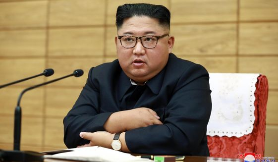 """In this Friday, Sept. 6, 2019, photo provided by the North Korean government, North Korean leader Kim Jong-un attends an emergency meeting to discuss disaster prevention efforts against Typhoon Lingling, in North Korea. Independent journalists were not given access to cover the event depicted in this image distributed by the North Korean government. The content of this image is as provided and cannot be independently verified. Korean language watermark on image as provided by source reads: """"KCNA"""" which is the abbreviation for Korean Central News Agency. (Korean Central News Agency/Korea News Service via AP)"""