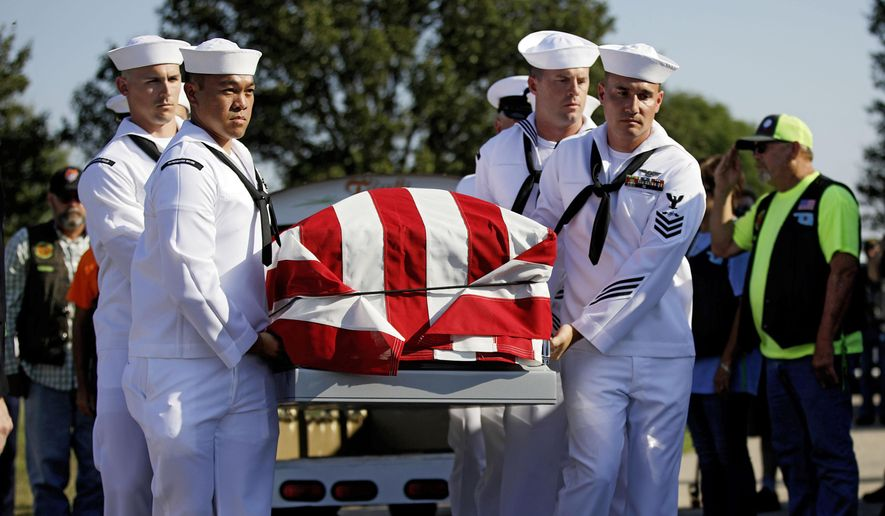 Sailors carry the casket of World War II veteran Herman White during his funeral Wednesday, Sept. 4, 2019. White had no surviving family, so the Brown-Dugger Funeral Home put out a notice asking for people to attend his funeral. (Mike Simons/Tulsa World via AP)