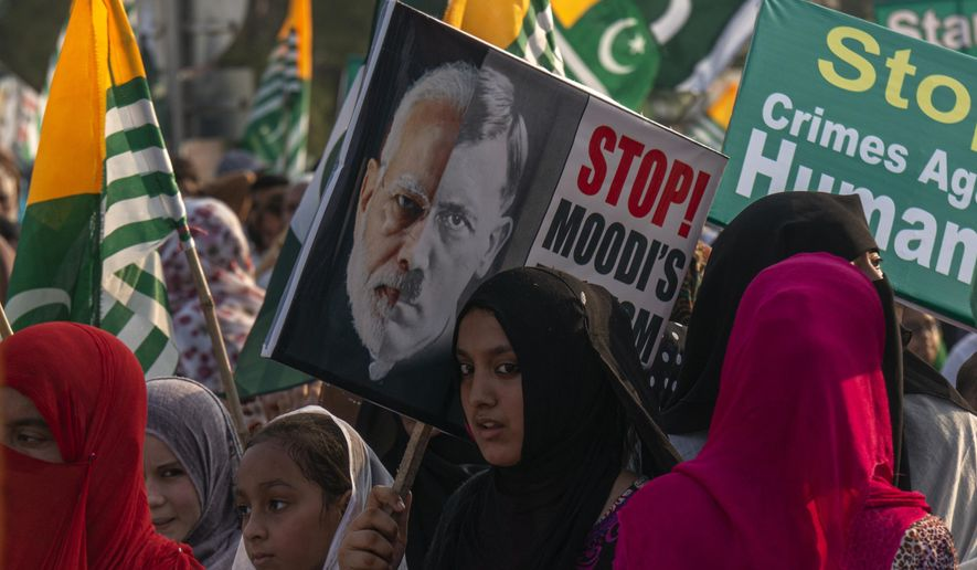 Pakistani Kashmiris rally near the Parliament House to express solidarity with Indian Kashmiris in Islamabad, Pakistan, Thursday, Sept. 5, 2019. The protests and anti-India rallies continued for the forth consecutive week in solidarity with Kashmiri people after the controversial bill was passed by India shrinking the rights of Kashmir people. (AP Photo/B.K. Bangash)