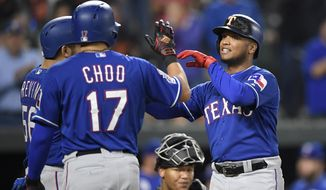 Texas Rangers' Willie Calhoun, right, celebrates his three-run home run with Shin-Soo Choo (17) and Jose Trevino, left, during the third inning of a baseball game against the Baltimore Orioles, Friday, Sept. 6, 2019, in Baltimore. Orioles catcher Pedro Severino, bottom center, looks on. (AP Photo/Nick Wass)