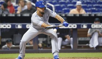 Kansas City Royals' Jorge Lopez bunts during the third inning of a baseball game against the Miami Marlins, Friday, Sept. 6, 2019, in Miami. (AP Photo/Wilfredo Lee)