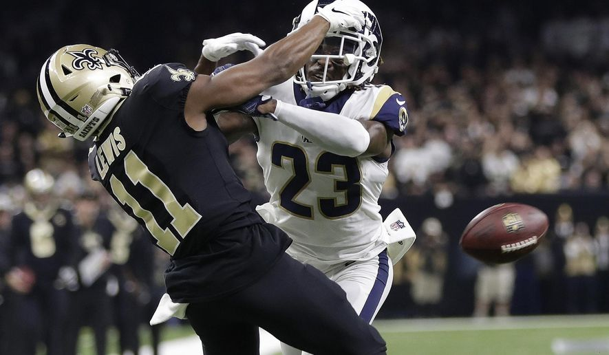 """FILE - In this Jan. 20, 2019, file photo, Los Angeles Rams' Nickell Robey-Coleman breaks up a pass intended for New Orleans Saints' Tommylee Lewis during the second half of the NFL football NFC championship game in New Orleans. Louisiana's Supreme Court has dismissed a Saints fan's lawsuit against the NFL and game officials over the failure to call a crucial penalty against the Los Angeles Rams in a January playoff game. Attorney Antonio LeMon had sued, alleging fraud and seeking damages over what's come to be known as the """"Nola No-Call.""""  (AP Photo/Gerald Herbert, File)"""