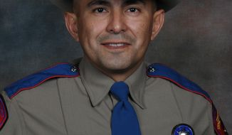 This undated photo provided by the Texas Department of Public Safety shows Services for Texas Department of Public Safety Trooper Moises Sanchez. A public funeral has been set for Friday, Sept. 6, 2019, for the state trooper who died more than four months after he was shot while investigating a vehicle collision in South Texas. (Texas Department of Public Safety via AP)