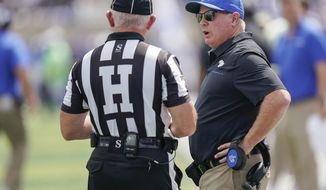 Kentucky head coach Mark Stoops speaks with an official during an NCAA college football game against Toledo, Saturday, Aug. 31, 2019, in Lexington, Ky. (AP Photo/Bryan Woolston)