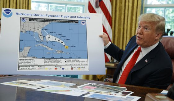 President Donald Trump talks with reporters after receiving a briefing on Hurricane Dorian in the Oval Office of the White House, Wednesday, Sept. 4, 2019, in Washington. (AP Photo/Evan Vucci)