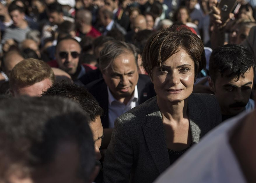 Canan Kaftancioglu, the head of Turkey's secular Republican People's Party in Istanbul, leaves the courthouse after her trial in Istanbul, Friday, Sept. 6, 2019. Turkey's state-run news agency says a court has sentenced the leader of the Istanbul branch of Turkey's main opposition party to nearly 10 years in prison over a series of tweets.(AP Photo)