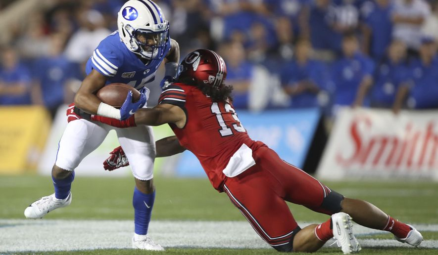BYU wide receiver Aleva Hifo (15) is tackled by Utah linebacker Francis Bernard (13) during the first half during an NCAA college football game Thursday, Aug. 29, 2019, in Provo, Utah. (AP Photo/George Frey)