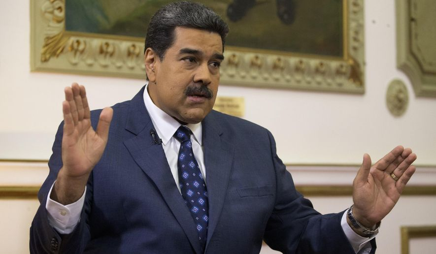 In this Feb. 14, 2019, file photo, Venezuela's President Nicolas Maduro speaks during an interview with The Associated Press at Miraflores presidential palace in Caracas, Venezuela. Maduro ordered on Tuesday, Sept. 3, 2019, Venezuela's military to hold exercises along the border with Colombia, accusing the neighboring nation's president of plotting an attack as tensions mount between the two South American countries. (AP Photo/Ariana Cubillos, File)