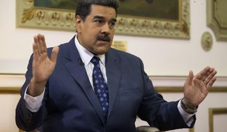 FILE - In this Feb. 14, 2019 file photo, Venezuela's President Nicolas Maduro speaks during an interview with The Associated Press at Miraflores presidential palace in Caracas, Venezuela. Maduro ordered on Tuesday, Sept. 3, 2019, Venezuela's military to hold exercises along the border with Colombia, accusing the neighboring nation's president of plotting an attack as tensions mount between the two South American countries. (AP Photo/Ariana Cubillos, File)