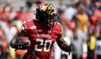 Maryland Terrapins running back Javon Leake (20) runs the ball during the first half of an NCAA college football game against the Syracuse Orange, Saturday, Sept. 7, 2019, in College Park, Md. (AP Photo/Will Newton) ** FILE **