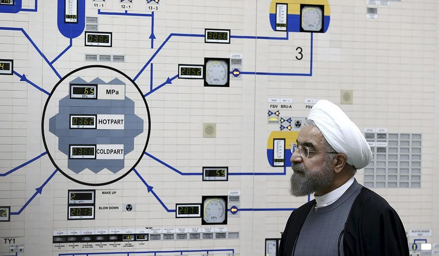 FILE - In this Jan. 13, 2015, file photo released by the Iranian President's Office, President Hassan Rouhani visits the Bushehr nuclear power plant just outside of Bushehr, Iran. Iran announced Saturday, Sept. 7, 2019, it had begun using advanced centrifuges in violation of its 2015 nuclear deal with world powers. (AP Photo/Iranian Presidency Office, Mohammad Berno, File)