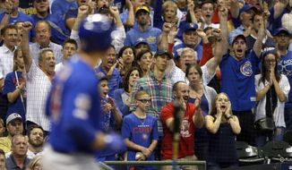 Fans react as Chicago Cubs' Anthony Rizzo draws a bases-loaded walk to score a run during the eighth inning of a baseball game against the Milwaukee Brewers, Saturday, Sept. 7, 2019, in Milwaukee. (AP Photo/Aaron Gash)
