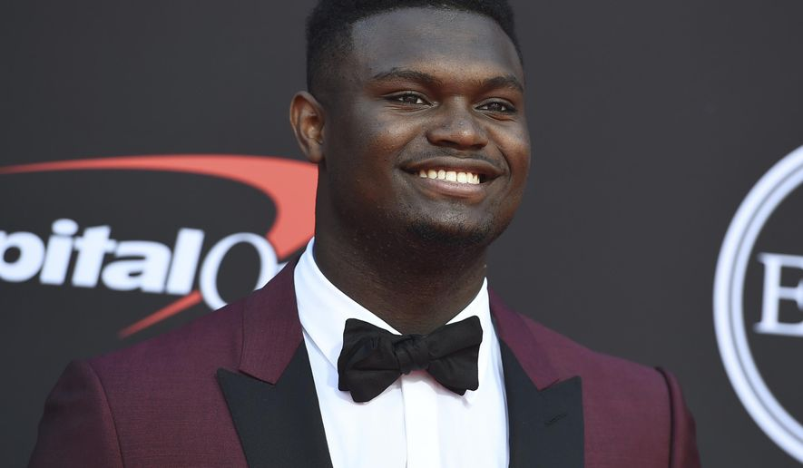 """FILE - In this July 10, 2019 file photo, Zion Williamson, of the Duke University Basketball team, arrives at the ESPY Awards at the Microsoft Theater in Los Angeles.  Duke says an investigation has found no evidence that Williamson received improper benefits. School spokesman Michael Schoenfeld said in a statement Saturday, Sept. 7,  that a """"thorough and objective"""" probe led by investigators outside the athletic department found """"no evidence to support any allegation"""" that would have jeopardized Williamson's eligibility. (Photo by Jordan Strauss/Invision/AP, File)"""