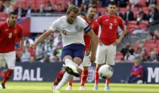 England's Harry Kane scores his side's second goal from the penalty spot during the Euro 2020 group A qualifying soccer match between England and Bulgaria at Wembley stadium in London, Saturday, Sept. 7, 2019. (AP Photo/Matt Dunham)
