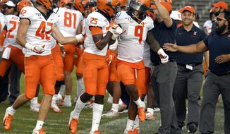 Illinois wide receiver Josh Imatorbhebhe (9) celebrates with his teammates after an interception against Connecticut late in the fourth quarter of an NCAA college football game, Saturday, Sept. 7, 2019, in East Hartford, Conn. (AP Photo/Jessica Hill)