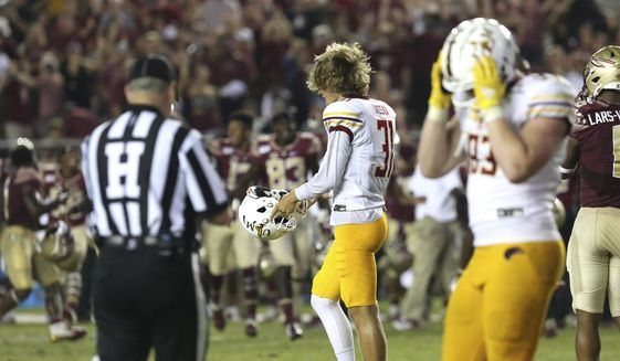 Louisiana-Monroe's kicker Jacob Meeks, center, reacts as he misses an extra point to give Florida State the win in overtime of an NCAA college football game Saturday, Sept. 7, 2019, in Tallahassee Fla. (AP Photo/Steve Cannon)