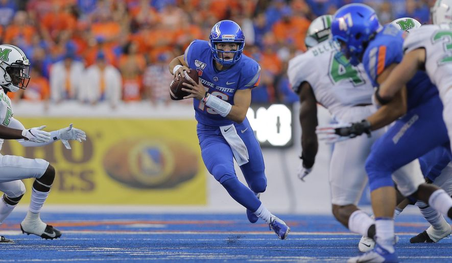 Boise State quarterback Hank Bachmeier (19) runs the ball during the first half of an NCAA college football game against Marshall in Boise, Idaho, Friday, Sept. 6, 2019. (AP Photo/Otto Kitsinger)