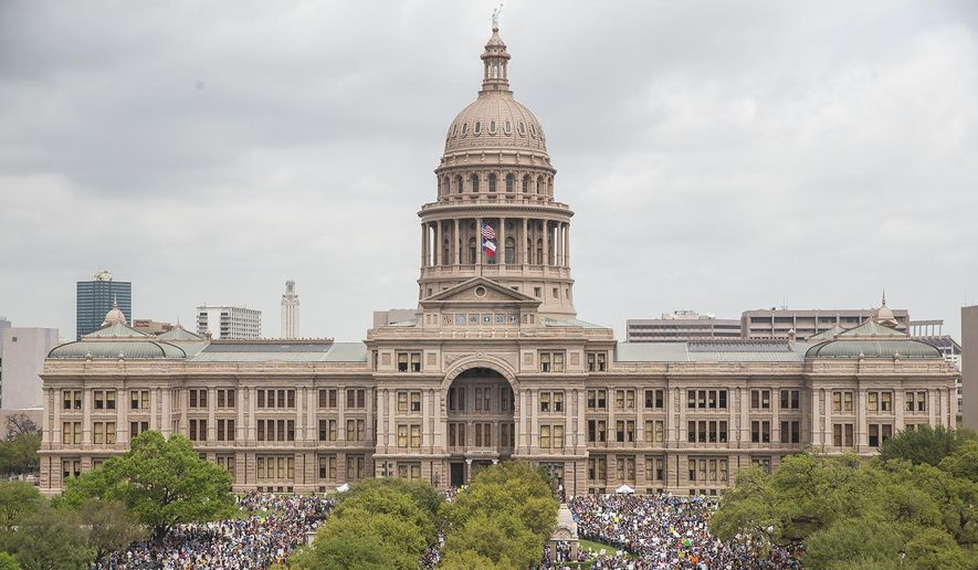 "In this March 24, 2018, file photo, thousands of people gather on the grounds of the Texas State Capitol during a ""March for Our Lives"" rally in Austin, Texas.  The vast majority of mass shooters have acquired their firearms legally with nothing in their background that would have prohibited them from possessing a gun. But there have been examples of lapses in the background check system that allowed guns to end up in the wrong hands. Very few states also have a mechanism to seize firearms from someone who is not legally allowed to possess one.(Nick Wagner/Austin American-Statesman via AP, File)"