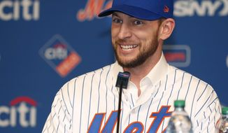 FILE - In this Wednesday, Jan. 16, 2019 file photo, New York Mets All-Star infielder Jed Lowrie smiles as he talks to the media during a press conference introducing him, after he signed with the team in New York. The Mets have activated infielder Jed Lowrie from the 60-day injured list for the first time this season, Saturday, Sept. 7, 2019. (AP Photo/Kathy Willens, File)