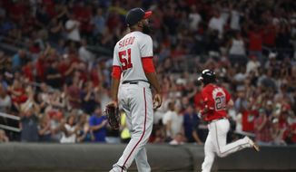Washington Nationals relief pitcher Wander Suero (51) paces near the mound as Atlanta Braves' Josh Donaldson (20) rounds the bases after a two-run home run during the seventh inning of a baseball game Friday, Sept. 6, 2019, in Atlanta. (AP Photo/John Bazemore) **FILE**