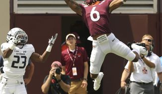 Virginia Tech receiver Hezekiah Grimsley (6) catches a 9 yard touchdown pass  in front of Old Dominion defender Geronda Hall Jr. (23) in the second quarter of an NCAA college football game  in Blacksburg Va,. Saturday, Sept. 7, 2019. (Matt Gentry/The Roanoke Times via AP)