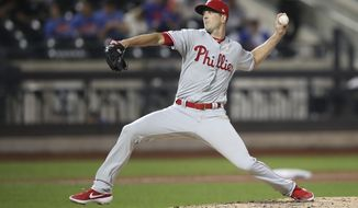 Philadelphia Phillies starting pitcher Drew Smyly delivers against the New York Mets during the third inning of a baseball game, Saturday, Sept. 7, 2019, in New York. (AP Photo/Mary Altaffer)