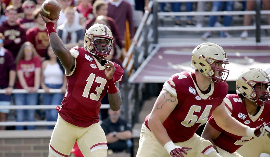 Boston College quarterback Anthony Brown (13) looks to pass as Ben Petrula (64) and AJ Dillon (2) block during the first half of an NCAA college football game, Saturday, Sept. 7, 2019, in Boston. (AP Photo/Mary Schwalm)