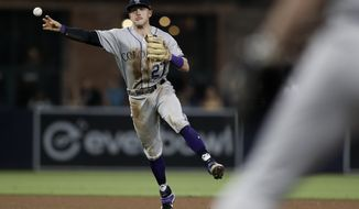 Colorado Rockies shortstop Trevor Story throws to first for an out against San Diego Padres' Luis Urias during the fourth inning of a baseball game Friday, Sept. 6, 2019, in San Diego. (AP Photo/Gregory Bull)