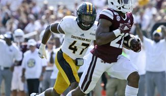 Mississippi State running back Nick Gibson (21) rushes for a touchdown as Southern Mississippi linebacker Terry Whittington (47) defends in the first half of an NCAA college football game Saturday, Sept. 7, 2019, in Starkville, Miss. (AP Photo/Jim Lytle)