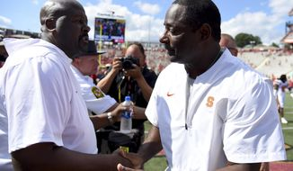 Maryland head coach Michael Locksley shakes hands with Syracuse head coach Dino Babers after an NCAA college football game, Saturday, Sept. 7, 2019, in College Park, Md. (AP Photo/Will Newton)
