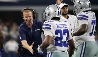 Dallas Cowboys head coach Jason Garrett, left, celebrates with Alfred Morris (23) after Morris carried the ball for a touchdown agains the Houston Texans in the first half of a preseason NFL football game in Arlington, Texas, Saturday, Aug. 24, 2019. (AP Photo/Ron Jenkins)