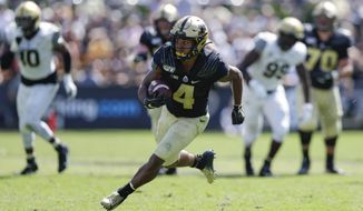 Purdue wide receiver Rondale Moore (4) runs after a catch against Vanderbilt during the second half of an NCAA college football game in West Lafayette, Ind., Saturday, Sept. 7, 2019. Purdue defeated Vanderbilt 42-24. (AP Photo/Michael Conroy)