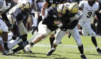 Purdue quarterback Elijah Sindelar (2) is tackled after a run by Vanderbilt safety Dashaun Jerkins (33) during the second half of an NCAA college football game in West Lafayette, Ind., Saturday, Sept. 7, 2019. Purdue defeated Vanderbilt 42-24. (AP Photo/Michael Conroy)